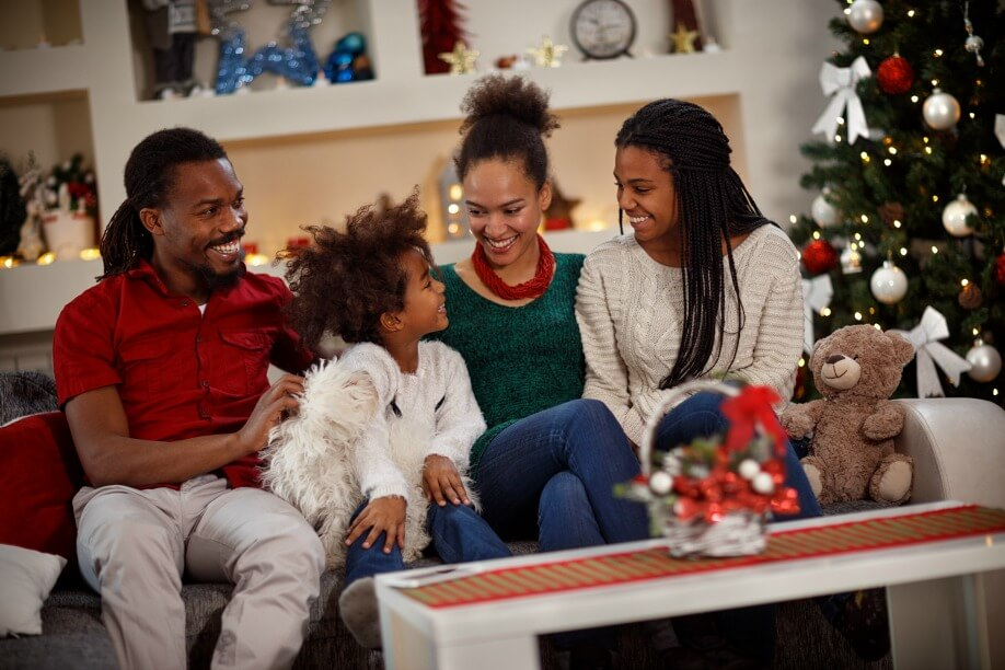Cheerful Afro-American family together for Christmas eve