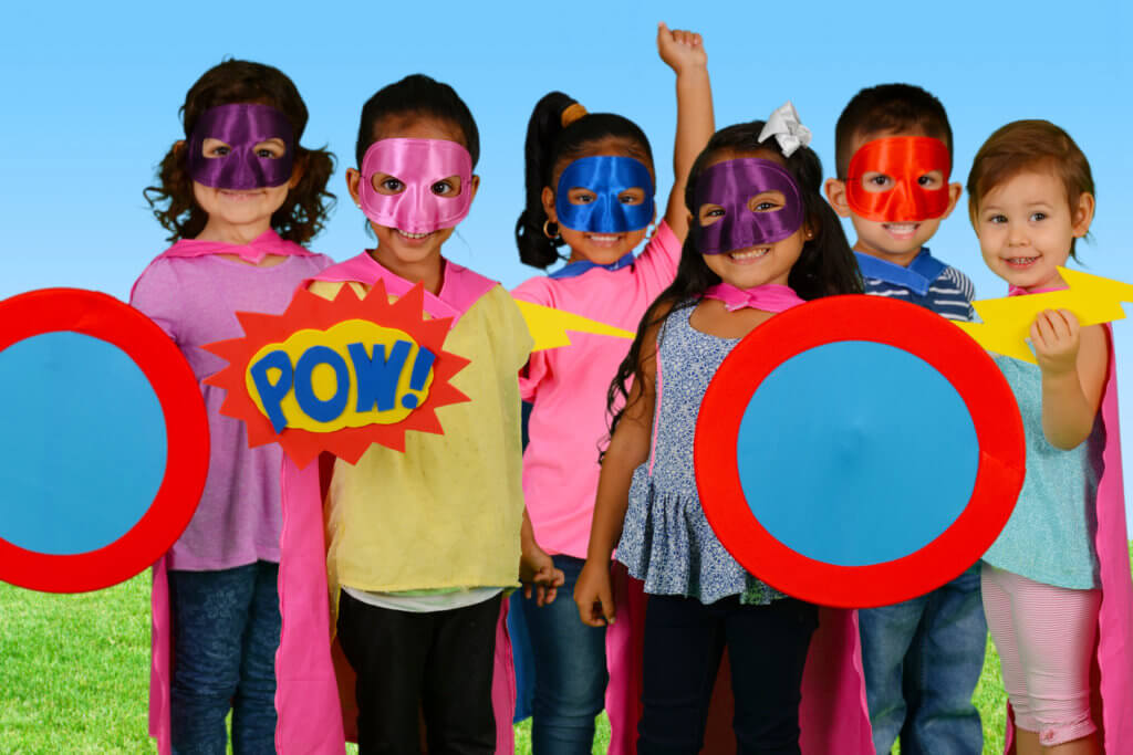 Group of children who are dressed up as superheroes