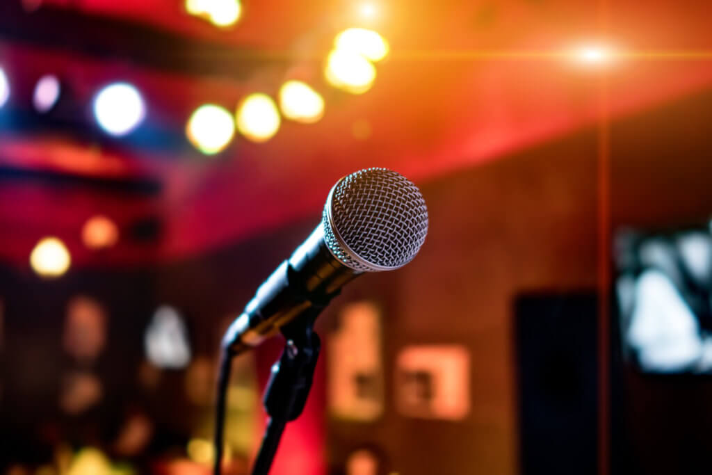 Microphone on stage against a background of auditorium