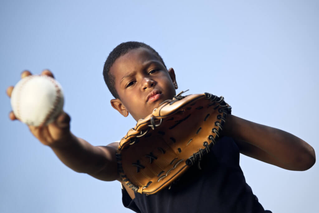 Sport, baseball and kids, portrait of child with glove holding ball and looking at camera