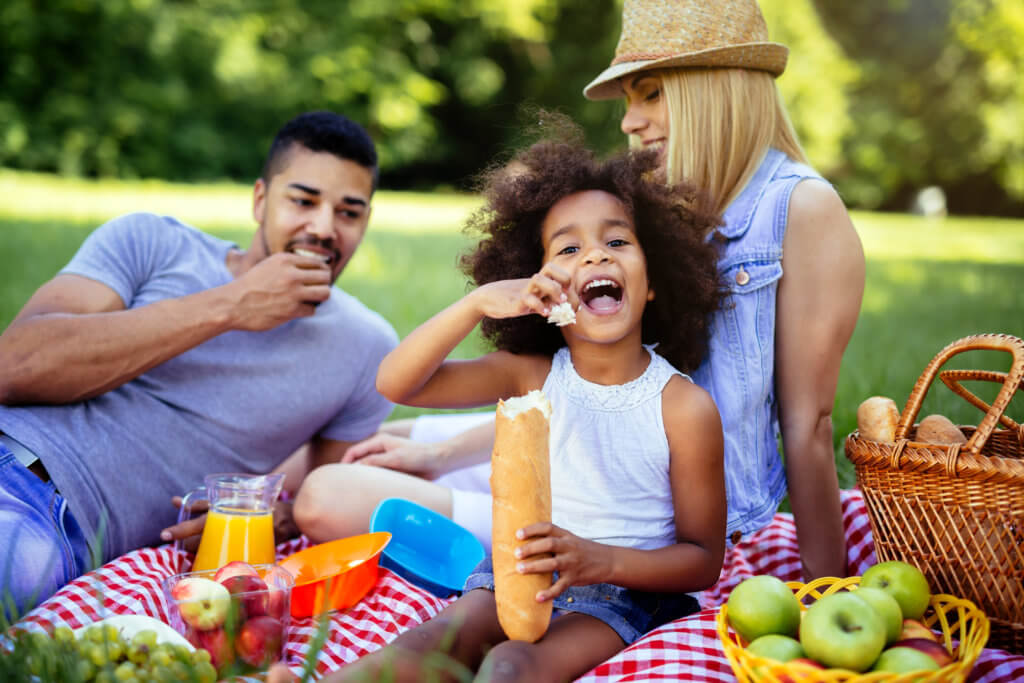 Family enjoying picnicking in nature