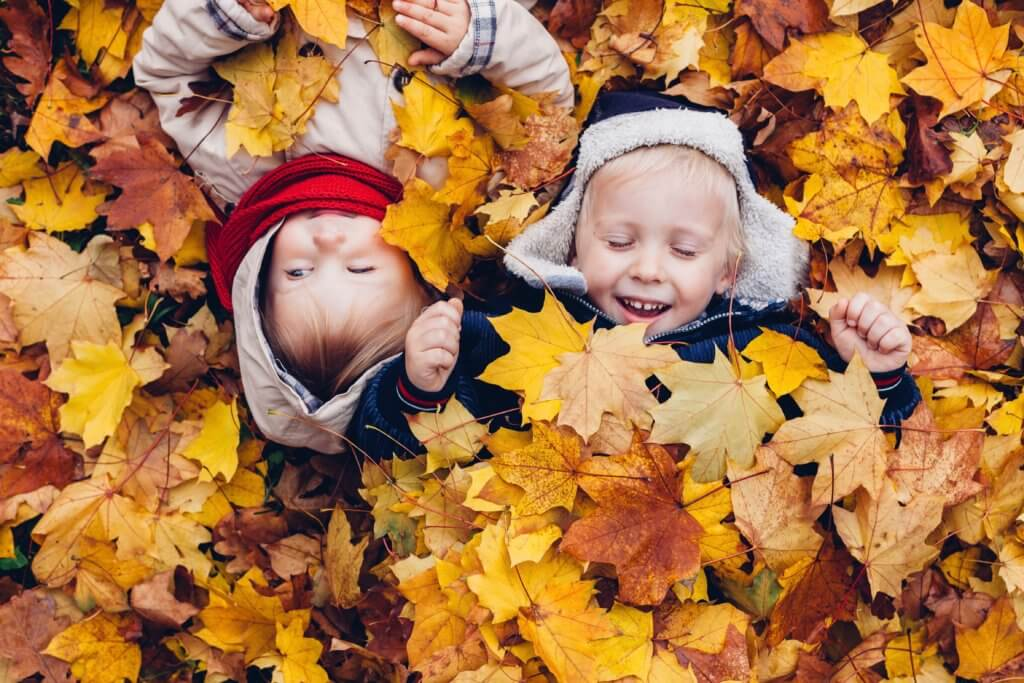 Children Enjoy in Autumn Leaves. Autumn Games.