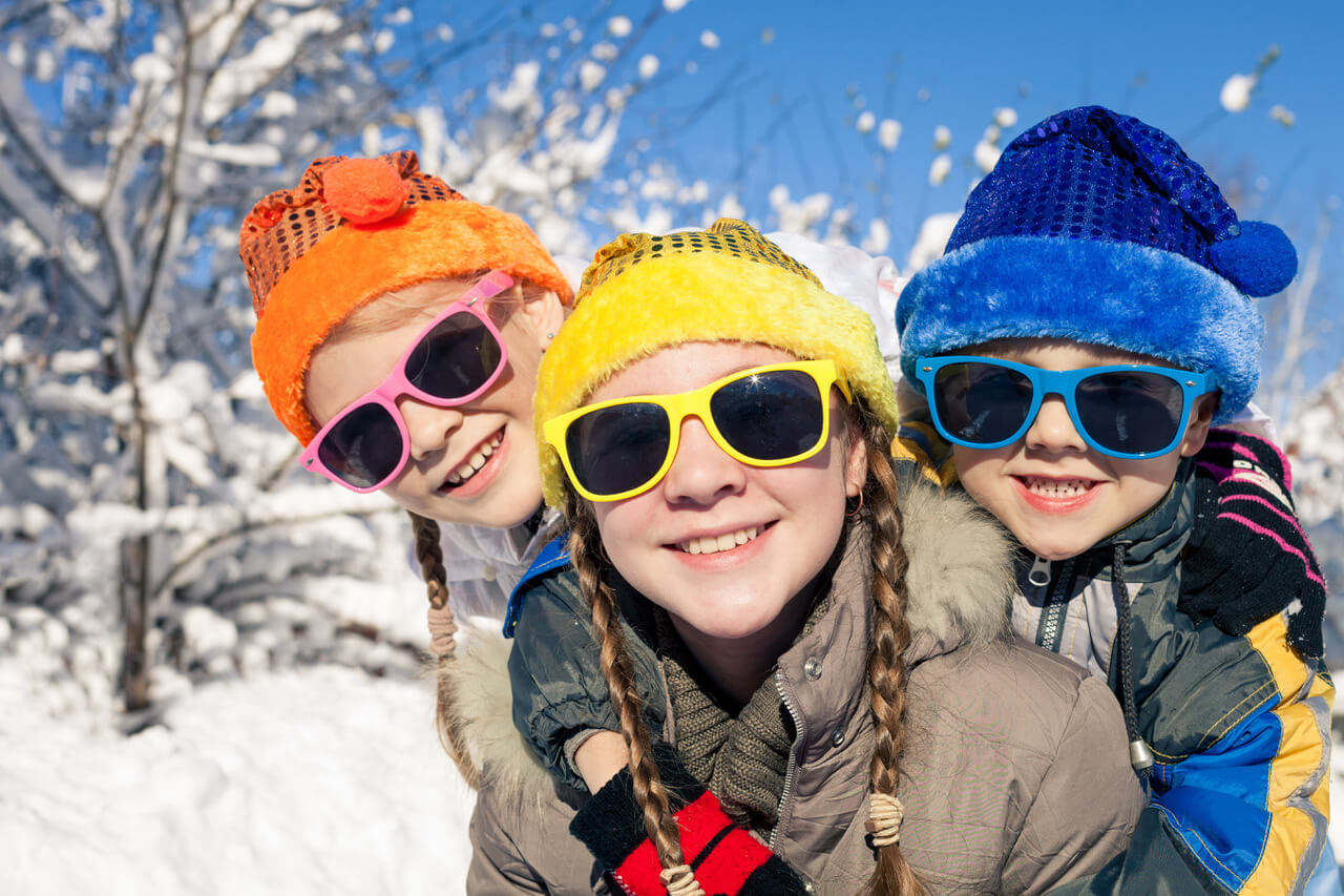 Cute Little Children Playing In Snow At A Winter Day. People Having Fun Outdoors. Concept Of Happy New Year.