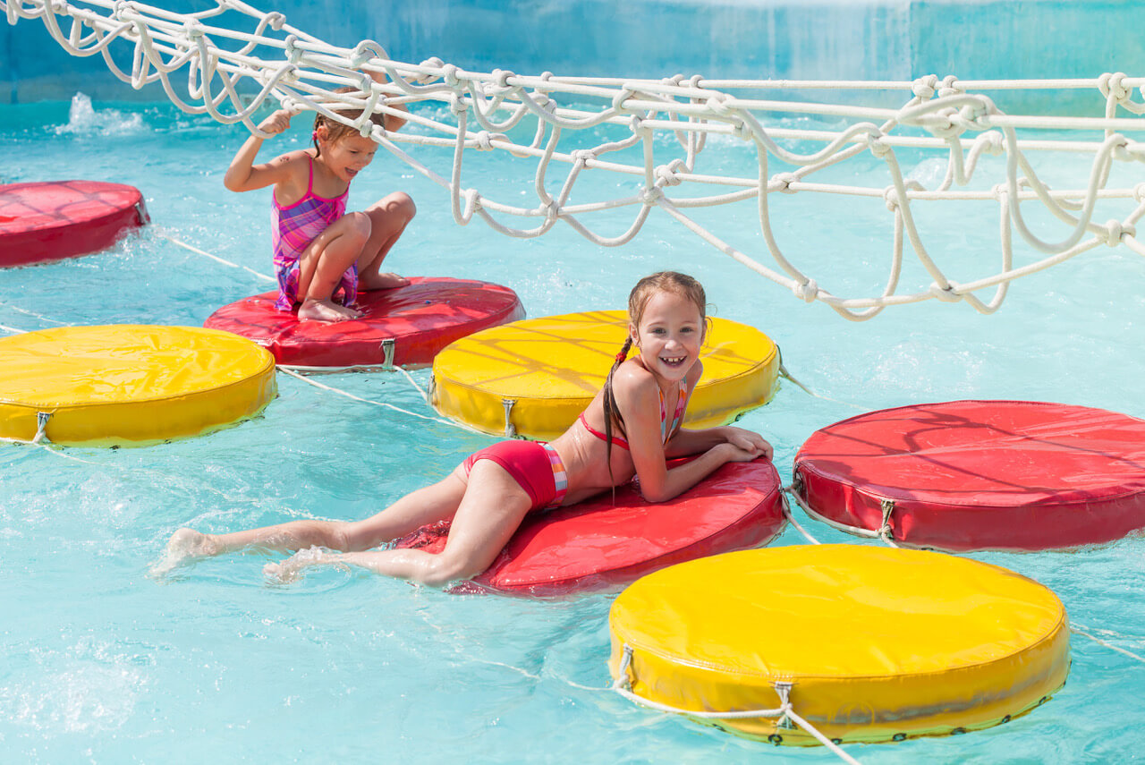 Two Little Girls Playing In The Waterpark