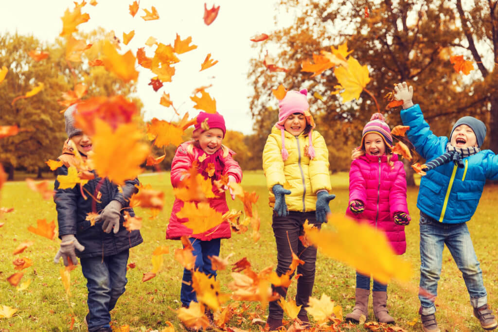 kids playing outside in fall
