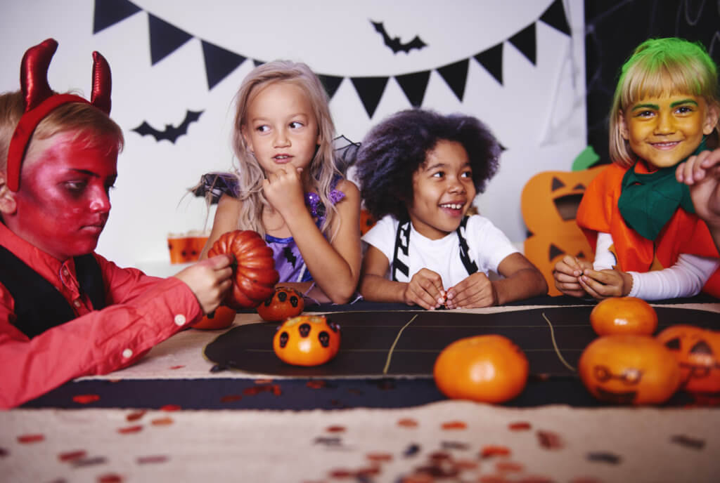 Children playing in costume at halloween party