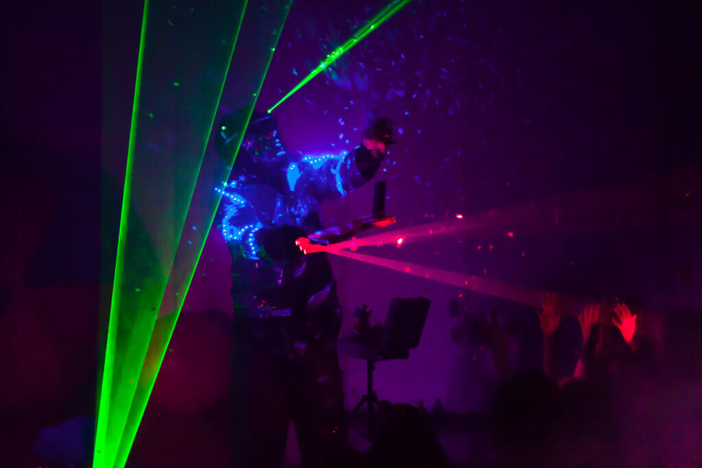 Colorful lights show. Laser show in motion in dark.