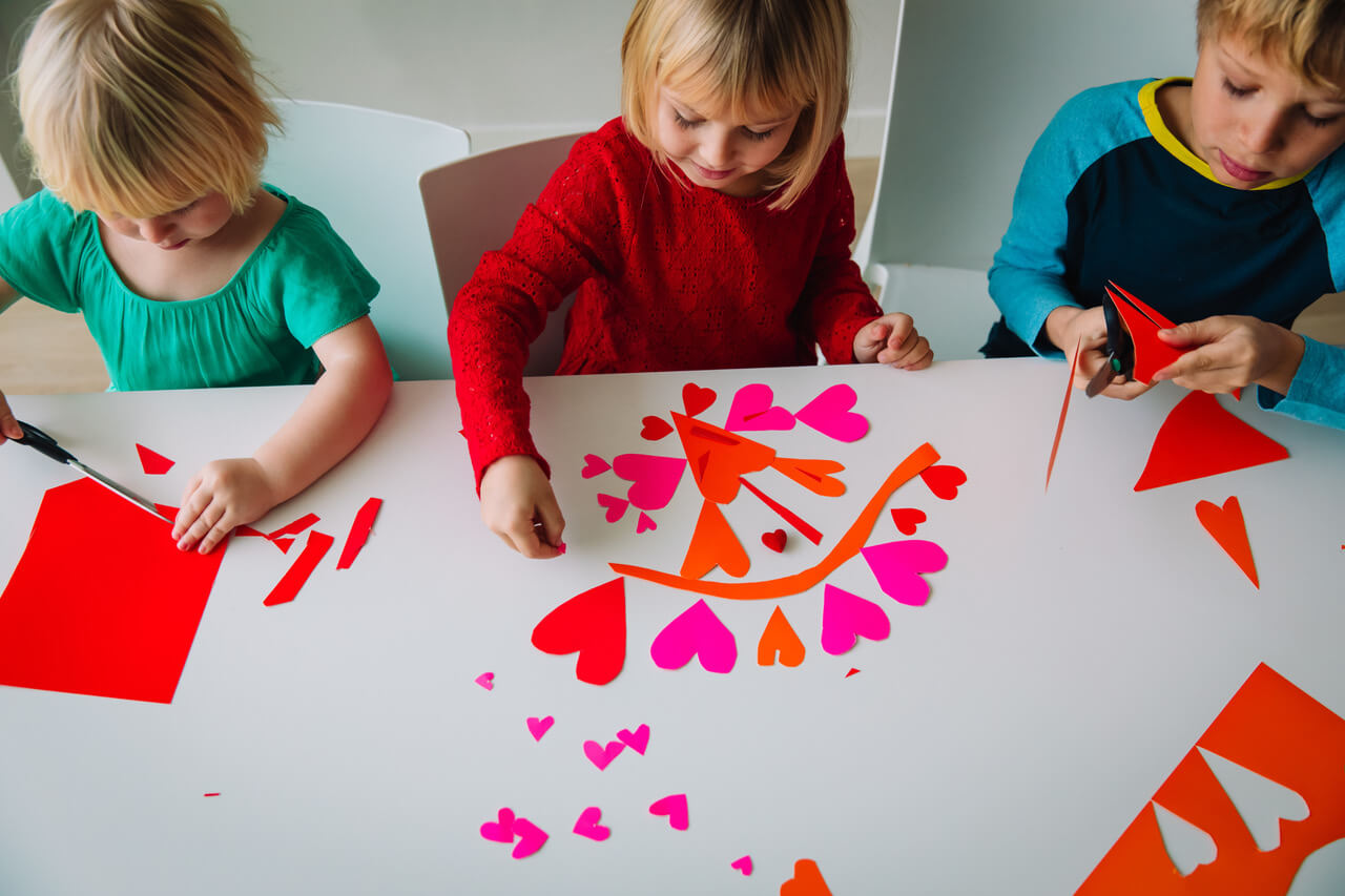 kids making hearts from paper, prepare for valentine day, kids crafts