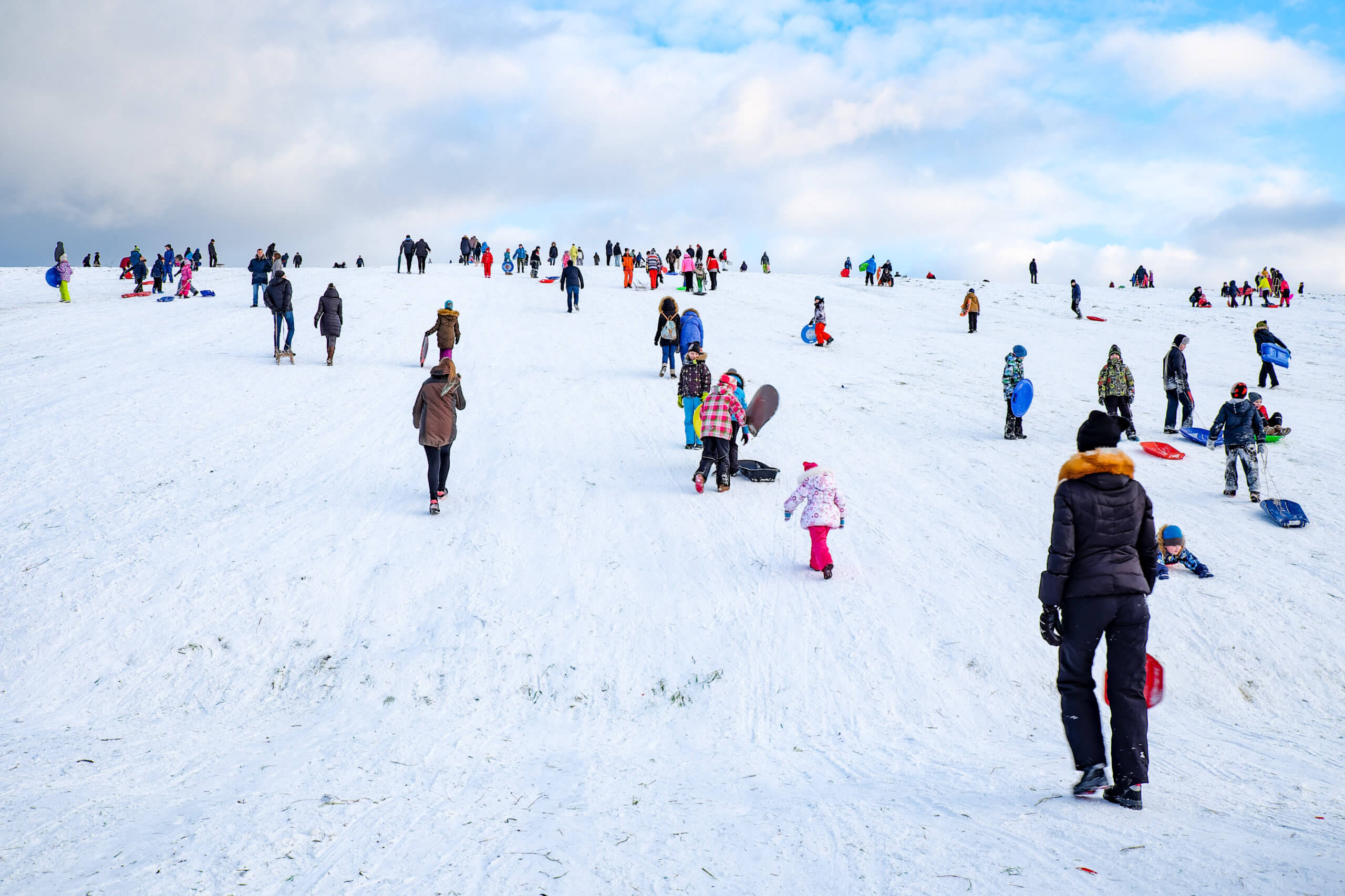 Snow Sledding Hill In A City Is Joy For Children And Adults