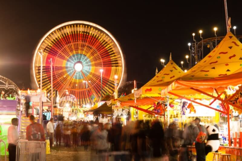 The Midway Is All Lit Up At Night With Motion Occuring In This Long Exposure At The State Fair